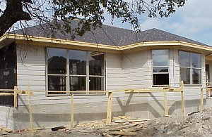 The siding on the back of the house has now been completed and the windows have been installed.