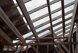 This picture shows the initial roof decking that has been installed.