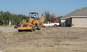 Clearing the front of the lot- pictures from the building of a custom home.