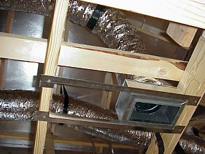 A view upward showing the air conditioning / heating ducts in the attic.