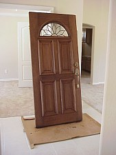 The front door is being stained on site.  The color of the stain was selected by the owners.