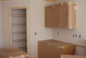 All of the cabinets are covered to protect them during painting.